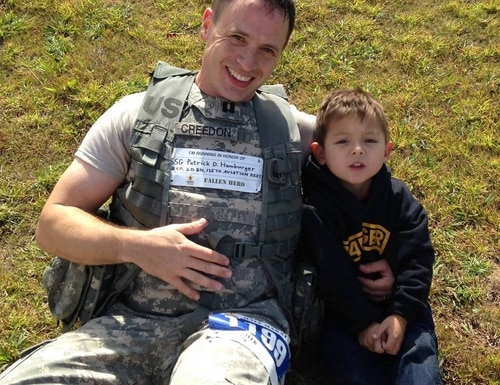 James Creedon poses with his son, Emmett, after running a half-marathon at Fort Benning, Georgia, in 2013. (Courtesy of James Creedon)