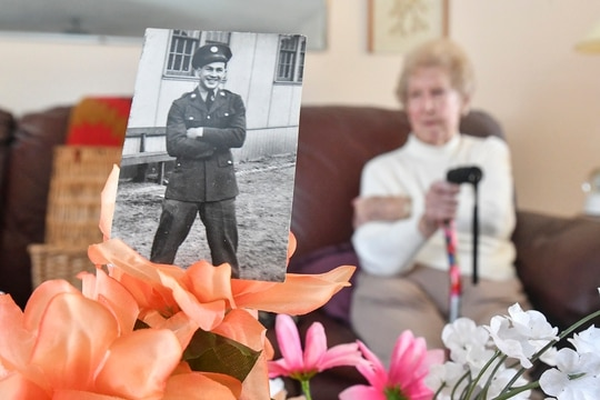 In this Jan. 24, 2020, photo, Ann Spearmint of Scranton, Pa., talks about her brother, Joseph Prokop, pictured at left, who died in the waning months of World War II. (Jason Farmer/The Times-Tribune via AP)