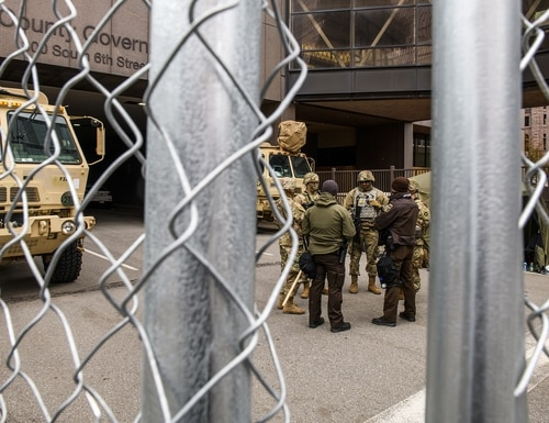 Law enforcement and National Guard members stage outside the Hennepin County Government Center on April 19, 2021, in Minneapolis. (Stephen Maturen/Getty Images)