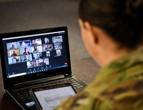 An Airman Leadership School instructor discusses online with students. (Senior Airman Christopher Quail/Air Force)