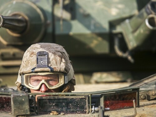Marine Corps Lance Cpl. Dakota Yates waits in a light armored vehicle for a convoy to depart from a command post in Hokkaido, Japan, during exercise Northern Viper 17. (Sgt. Ally Beiswanger/Marine Corps)