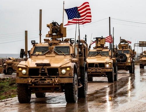 American soldiers patrol on the M4 highway in the town of Tal Tamr in the northeastern Syrian Hasakeh province on the border with Turkey on Jan. 24, 2020. (Delil Souleiman/AFP via Getty Images)