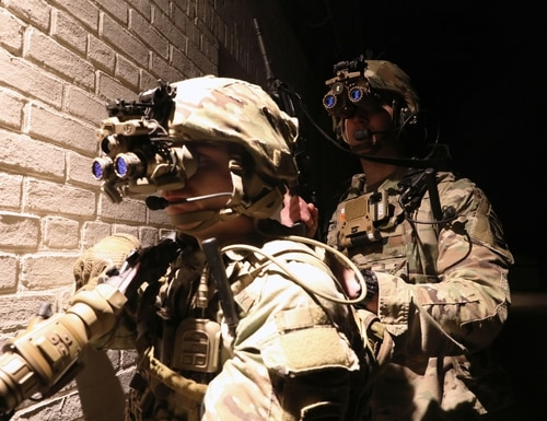 Soldiers don the Enhanced Night Vision Goggle during a live fire event at Aberdeen Proving Ground, Md., in February 2021. (Courtney Bacon/Army)