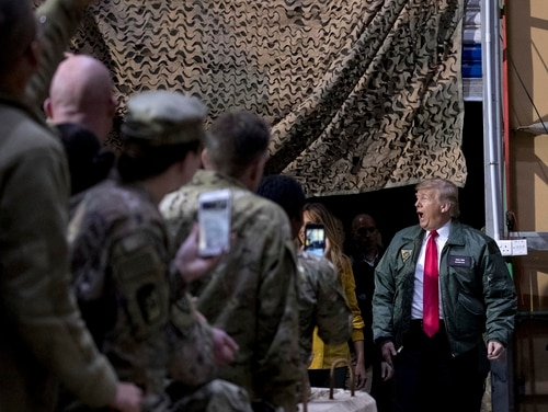 President Donald Trump arrives at Al Asad Air Base in Iraq on Dec. 26, 2018. In a surprise trip to Iraq, he said that troops received their first pay raise in a decade under his leadership, an incorrect statement he has repeated often in the last year. (Andrew Harnik/AP)