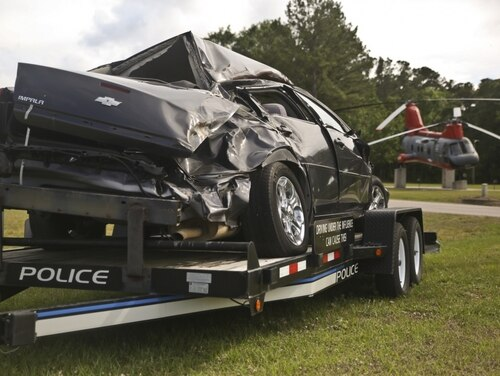 A static display of a wrecked car is displayed aboard MCAS Beaufort. Drunk driving has risen significantly among veterans since 2014. (Lance Cpl. Terry Haynes/Marine Corps)
