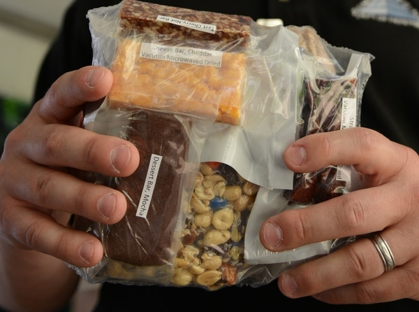 The prototype Close Combat Assault Ration on display at the Pentagon May 24 includes a tart cherry nut bar, cheddar cheese bar, mocha desert bar, vacuum-dried strawberries and trail mix of fruit and nuts.(Gary Sheftick/Army)
