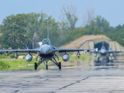 Two U.S. Air Force F-16 Fighting Falcons assigned to the 555th Fighter Squadron taxis on the flightline during Thracian Star 21 at Graf Ignatievo Air Base, Bulgaria, July 20, 2021. (U.S. Air Force photo by Airman 1st Class Brooke Moeder)