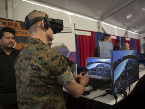 A U.S. Marine tests a new virtual reality system during the Marine South Expo on Camp Lejeune, N.C., April 11, 2018. (U.S. Marine Corps photo by Lance Cpl. Michaela R. Gregory)
