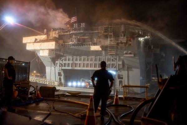 Sailors combat a fire aboard the amphibious assault ship Bonhomme Richard (LHD 6) on July 13 in San Diego. (MC3 Hector Carrera/Navy)