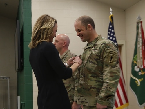 Matthew O. Williams is promoted by his wife during a ceremony on Feb. 28, 2020. (Sgt. Robert Monteith/Army)