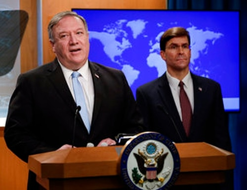 Secretary of State Mike Pompeo speaks as Defense Secretary Mark Esper listens, during a joint briefing, Thursday, June 11, 2020 at the State Department in Washington, on an executive order signed by President Donald Trump aimed at the International Criminal Court. (Yuri Gripas/Pool via AP)