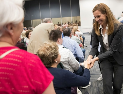 Navy veteran Mikie Sherrill greets voters during a candidate forum in New Jersey on Oct. 9, 2018. Sherrill is one of 17 new veteran candidates to win a congressional seat in Tuesday's midterm elections. (Mary Altaffer/AP)