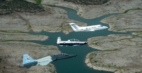 A T-1 Jayhawk, T-6 Texan II, and T-38 Talon fly in formation near Laughlin Air Force Base, Texas. Dissimilar formations are typically flown for pilots finishing Undergraduate Pilot Training. (Senior Airman Moshe Paul/Air Force)