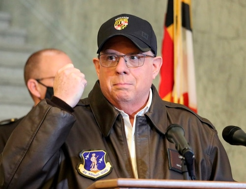 Maryland Gov. Larry Hogan holds his hand up during a news conference in Annapolis, Md., on Thursday, Jan. 7, 2021, as he describes phone conversations he had with Maryland Rep. Steny Hoyer and Secretary of the Army Ryan McCarthy on sending Maryland National Guard members to help protect the U.S. Capitol after rioters stormed the building a day earlier. (Brian Witte/AP)