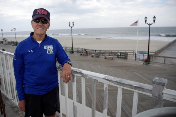 In a photo taken Thursday, Sept. 14, 2017, Frank Costello, organizer of the Semper Five charity run in Seaside Heights, N.J., poses for photograph near the site of the start and finish lines for the race. The photo was taken a after a pipe bomb blast disrupted the charity race to benefit Marines and marked the start of a two-day reign of terror in the region. (Julio Cortez/AP)