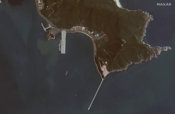 This satellite image collected Nov. 19 via the WorldView-1 satellite shows China's first domestically built aircraft carrier shortly after arriving in port near the Yulin Naval Base on Hainan island, China. The carrier has been referred to as Type-001A. It was sailing through the Taiwan Strait on Nov. 17. Seven Shenyang J-15 fighter aircraft can be seen on the deck of the carrier along with several helicopters, their blades stowed in a travel position. (Maxar Technologies)