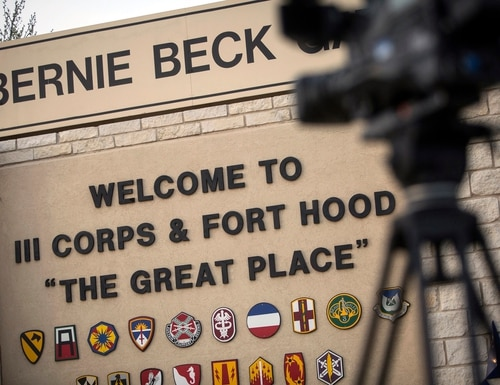 In this April 2, 2014, file photo, members of the media wait outside of the Bernie Beck Gate, an entrance to the Fort Hood military base in Fort Hood, Texas. (Tamir Kalifa/AP)