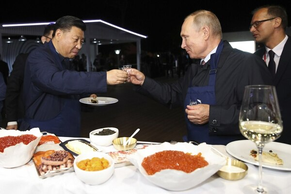 Chinese President Xi Jinping, left, and Russian President Vladimir Putin toast at the Eastern Economic Forum in Vladivostok, Russia, in September 2018. The U.S. is in an era of hyper-competition with Russia and China's rising military ambitions, according to U.S. Army Pacific commander Gen. Robert Brown. (Sergei Bobylev/Tass News Agency via AP)