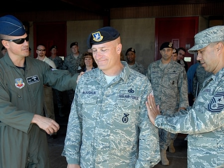 Senior Master Sgt. Timothy McLaughlin receives notification of his promotion to chief master sergeant at Holloman Air Force Base, N.M. The Air Force will allow some chief-selects to wear their rank early under a practice known as frocking. (SrA Anthony Nelson/Air Force)