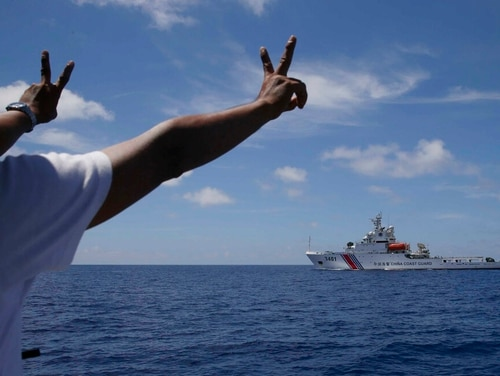 In this March 29, 2014, photo, a Chinese Coast Guard ship attempts to block a Philippine government vessel from entering the Ayungin Shoal. (Bullit Marquez/AP)