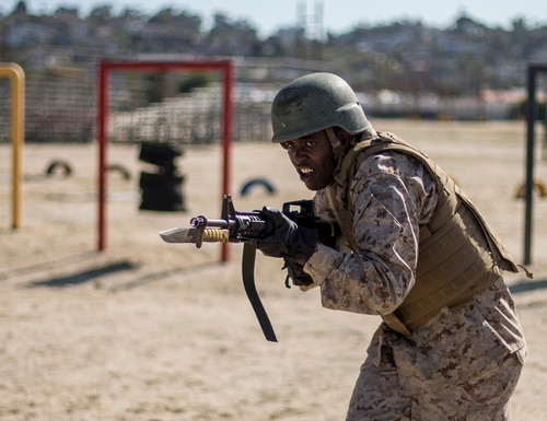 A recruit with Echo Company, 2nd Recruit Training Battalion participates in the Bayonet Assault course at Marine Corps Recruit Depot, San Diego, May 20, 2020. (Lance Cpl. Grace J. Kindred/Marine Corps)