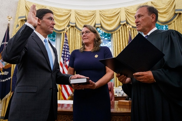 Mark Esper, left, is sworn in as the Secretary of Defense by Supreme Court Justice Samuel Alito, right, as his wife Leah Esper holds the Bible, during a ceremony with President Donald Trump in the Oval Office at the White House in Washington, Tuesday, July 23, 2019. (Carolyn Kaster/AP)