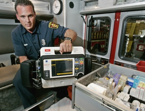 Los Angeles Fire Department paramedic Damon Leach holds a defibrillator next to a drawer of medication used in an Advanced Life Support rescue ambulance at Fire Station 3 in downtown Los Angeles, Wednesday, April 20, 2005. A $5.95 billion budget for 2005-2006 proposed by Mayor James Hahn calls for, among other things, 720 new police officers, 48 more paramedics and the upgrading of eight RAs staffed by firefighters to full ALS rigs staffed by paramedics, bringing the city total to 87. The proposed budget is about 10.5 percent more than this fiscal year. (AP Photo/Reed Saxon)