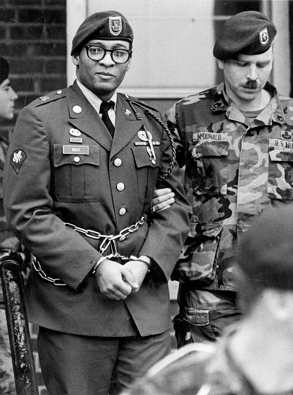 FILE - In this April 6, 1988, file photo, Ronald Gray leaves a courtroom escorted by military police at Fort Bragg, N.C. A Kansas federal judge has lifted a stay of execution for Gray, a former soldier who was sentenced to death for killing two women and a series of rapes, moving him closer to becoming the military's first death sentence carried out in more than a half century. No known execution date has been set for Gray as of Tuesday, Dec. 27, 2016. (Marcus Castro/The Fayetteville Observer via AP, File)