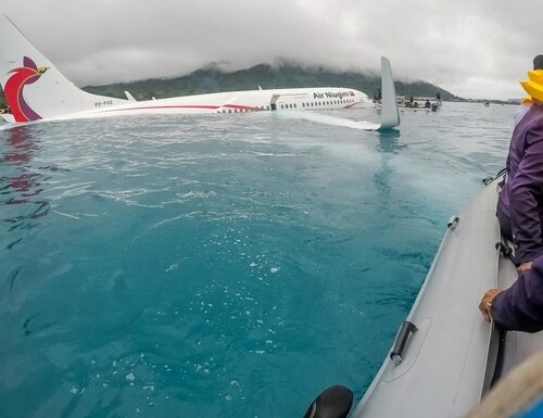 Sailors from Underwater Construction Team 2 join local authorities in shuttling the passengers and crew of Air Niugini flight PX56 to shore following the plane crashing into the sea on its approach to Chuuk International Airport in the Federated States of Micronesia last week. (Lt. Zach Niezgodski/Navy)
