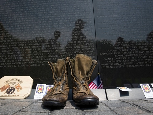 A pair of military boots are left at the Vietnam Veterans Memorial during the 30th anniversary of the Rolling Thunder 'Ride for Freedom' demonstration in Washington, on May 28, 2017. Advocates for sailors who served off the coast of Vietnam during the war hope that lawmakers will consider easing rules for compensation claims related to Agent Orange exposure. (Cliff Owen/AP)