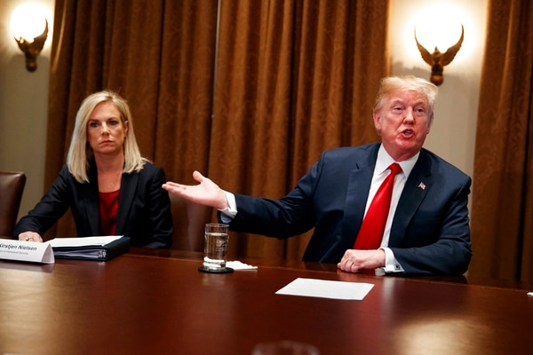 Secretary of Homeland Security Kirstjen Nielsen listens as President Donald Trump speaks during a meeting with law enforcement officials on the MS-13 street gang and border security, in the Cabinet Room of the White House, Tuesday, Feb. 6, 2018, in Washington. (Evan Vucci/AP)