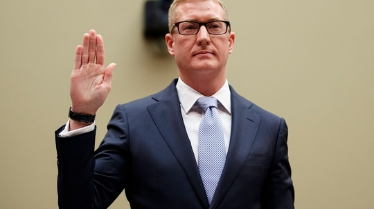 Deputy Assistant Attorney General for National Security Adam Hickey, is sworn in to testify on Capitol Hill in Washington, Wed., May 22, 2019, before the House Oversight and Reform National Security subcommittee hearing on