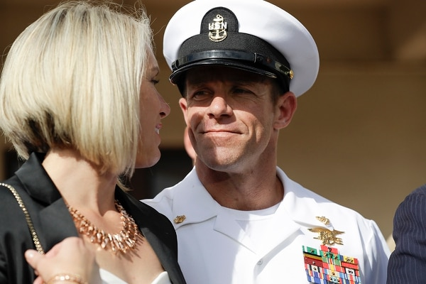 """Special Warfare Operator Chief Edward """"Eddie"""" Gallagher and his wife Andrea leave a military court on Naval Base San Diego on July 2. (Gregory Bull/AP)"""