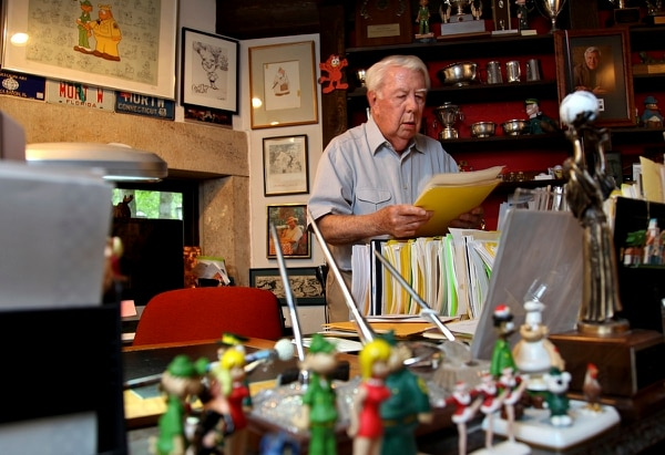 Mort Walker, the artist and author of the Beetle Bailey comic strip, looks over notes and documents in his studio in Stamford, Conn., in this Aug. 16, 2010, photo. Walker died Jan. 27, 2018. He was 94. (Craig Ruttle/AP)