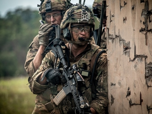 Soldiers assigned to 1st Battalion, 21st Infantry Regiment, 2nd Infantry Brigade Combat Team, 25th Infantry Division, prepare to clear a building during a combined arms live-fire exercise at Schofield Barracks, Hawaii. (1st Lt. Ryan DeBooy/Army)