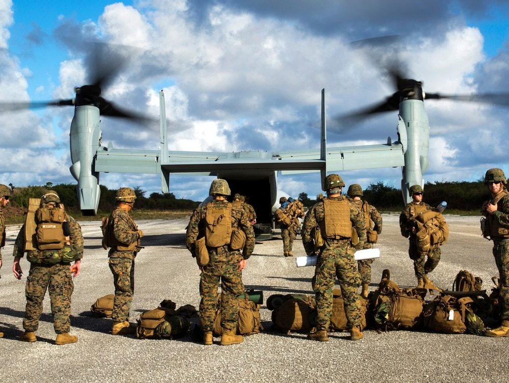 Marines disembarks an MV-22B Osprey on Dec. 9, 2013, at Baker runway on Tinian's North Field on Guam. ( Lance Cpl. Antonio Rubio/Marine Corps)