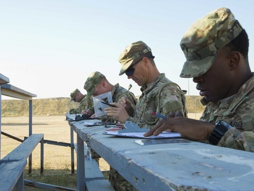 Soldiers in the first Army Central Basic Leader Course plot points on their maps before hitting the land navigation range at Camp Buehring, Kuwait. The Army is poised to introduce an all-new Basic Leader Course as part of a larger education overall for enlisted soldiers. (Sgt. Youtoy Martin/Army)