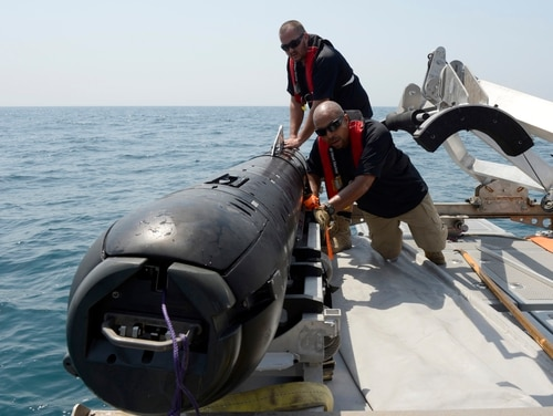 120827-N-WB378-475 U.S. 5TH FLEET AREA OF RESPONSIBILITY (Aug. 27, 2012) Civilian contractors secure an M18 Mod 2 Kingfish unmanned underwater vehicle to the deck of an 11-meter rigid hull inflatable boat. The Kingfish uses side scan sonar to search and discover objects of interest. This marks the first time the vehicles have been added to mine countermeasure operations in the U.S. 5th Fleet area of responsibility. (U.S. Navy photo by Mass Communication Specialist 2nd Class Blake Midnight/Released)