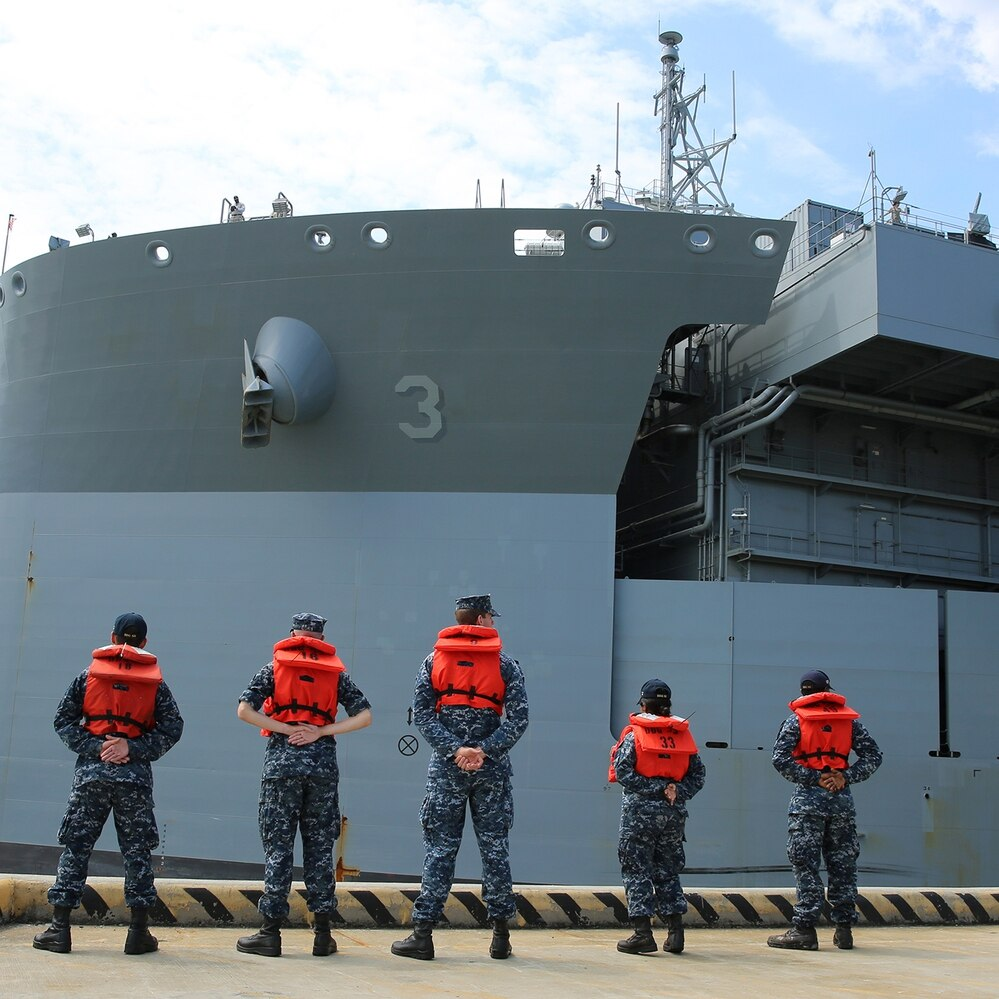 Navy sailors observe the expeditionary mobile base USNS Lewis B. Puller (T-ESB 3) as the ship gets underway from Naval Station Norfolk to begin its first operational deployment, July 10, 2017. Puller is deploying to the U.S. Fifth Fleet's area of operation in support of U.S. Navy and allied military efforts in the region. (Bill Mesta/Navy)