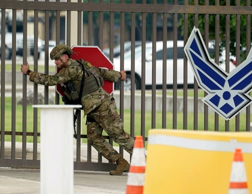 A military policeman closes a gate at JBSA-Lackland Air Force Base Wednesday, June 9, 2021, in San Antonio. The Air Force was put on lockdown as police and military officials say they searched for two people suspected of shooting into the base from outside. (Eric Gay/AP)