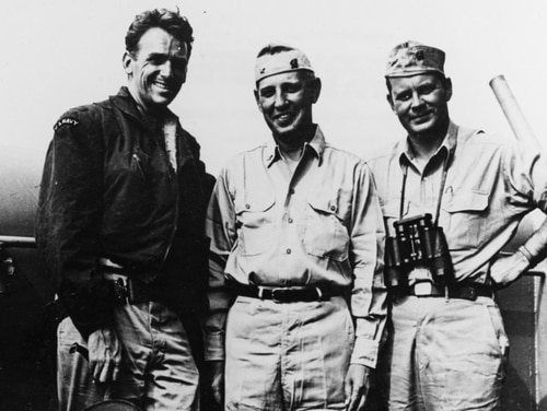 Lt. Cmdr. Douglas Fairbanks, Jr., Capt. Henry C. Johnson and Lt. Cmdr. John D. Bulkeley (commander of the Special Operations Group's Eastern Diversionary Unit, commander of CTG 80.4 and the commanding officer of the destroyer Endicott), during operations off France in August of 1944. (Courtesy of Rear Adm. John D. Bulkeley, now in the collections of U.S. Naval History and Heritage Command)