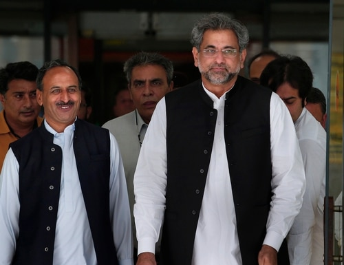 Pakistan's premier-designate Shahid Khaqan Abbasi, right, leaves with his aids after meeting with politicians in Parliament in Islamabad, Pakistan, on July 31, 2017. (Anjum Naveed/AP)