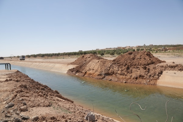 Water flows through the Adnanea Canal once again after a dirt bridge is removed in Adnanea, Syria, April 2, 2018. Repairs to the canal restore water to over 500 acres of farmland and provide drinking water as far as northern Raqqa. (Staff Sgt. Ambraea Johnson/Army)