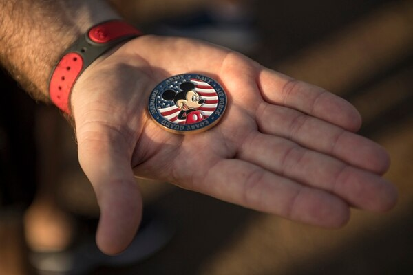 Disney Parks, Experiences and Products Chairman Bob Chapek provided a Disney-themed challenge coin to five active-duty servicemembers representing Army, Navy, Marine Corps, Air Force and Coast Guard in gratitude of their military service.