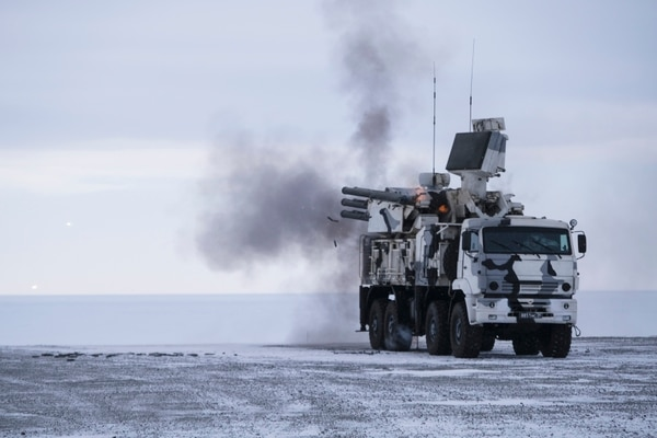A Russian Pansyr-S1 air defense system fires at a practice target during a recent military drill on Kotelny Island. (Vladimir Isachenkov/AP)