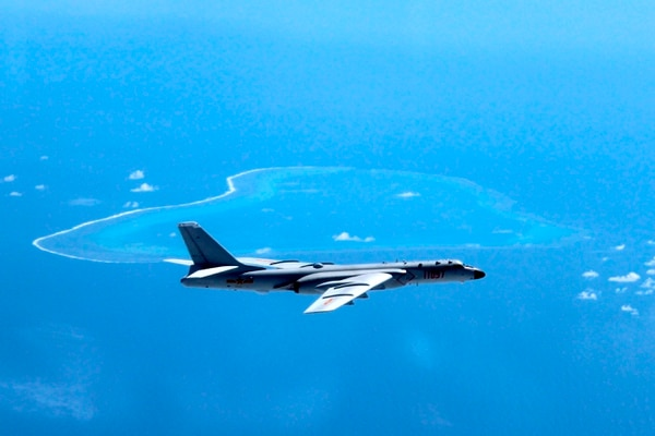 In this undated photo, a Chinese H-6K bomber patrols the islands and reefs in the South China Sea. (Liu Rui/Xinhua via AP)