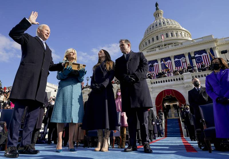 oe Biden is sworn in as the 46th president of the United States by Chief Justice John Roberts as Jill Biden holds the Bible during the 59th Presidential Inauguration at the U.S. Capitol in Washington, Wednesday, Jan. 20, 2021, as their children Ashley and Hunter watch.