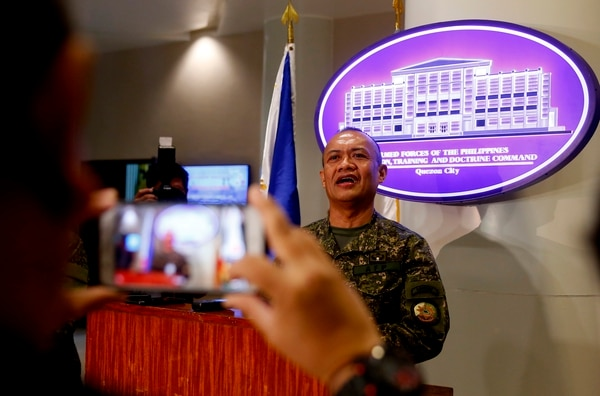 Commodore Adeluis Bordado answers questions from the media following the opening ceremony for the two-week military exercise involving four major services of the country's armed forces Monday in Manila. (Bullit Marquez/AP)