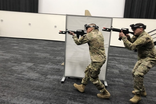 FORT BELVOIR, Virginia - Sergeant Major of the Army Michael Grinston runs through a shooting scenario with the Integrated Visual Augmentation System, or IVAS. (Todd South/Military Times)