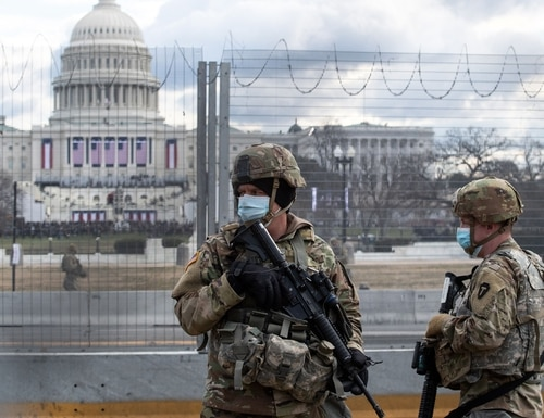 National Guard troops patrol the vicinity of the U.S. Capitol on Jan. 20, 2021. (Roberto Schmidt/AFP via Getty Images)